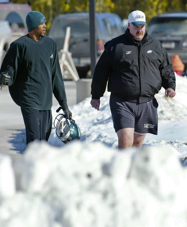 Philadelphia Eagles wide receiver Todd Pinkston, left, and coach Andy Reid walk past snowbanks to a heated practice field Thursday, Jan. 27, 2005, in Philadelphia. The Eagles play the New England Patriots in the Super Bowl XXXIX on Sunday, Feb. 6, 2005 in Jacksonville, Fla. (AP Photo/George Widman)