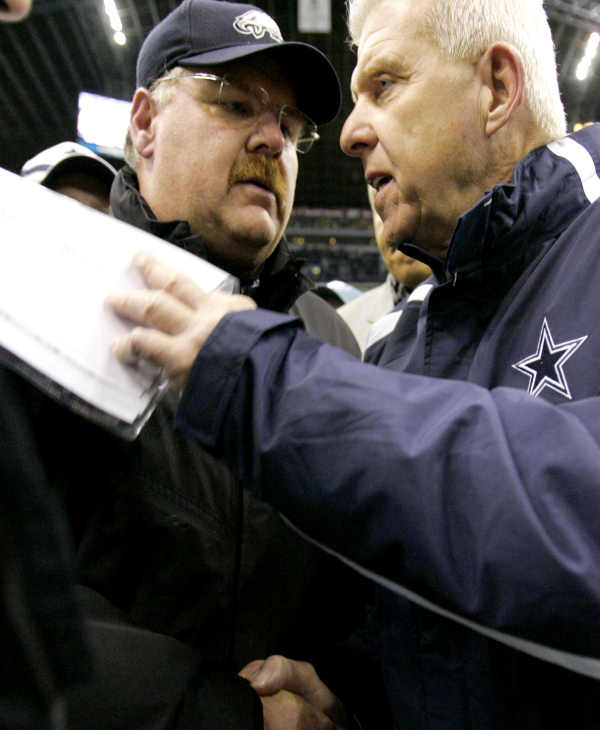 Philadelphia Eagles coach Andy Reid, left, and Dallas Cowboys coach Bill Parcells meet on the playing field after the Eagles beat the Cowoys 23-7, in their NFL football game in Irving, Texas, Monday, Dec. 25, 2006. (AP Photo/Tony Gutierrez)