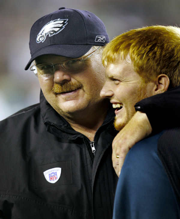** FILE ** Philadelphia Eagles head coach Andy Reid, left, hugs his son, Britt, after the Eagles defeated the Dallas Cowboys 38-24 in their football game Oct. 8, 2006, in Philadelphia. Reid will take a temporary leave of absence through the middle of March to deal with family issues, team officials announced Monday, Feb. 12, 2007. Reid's decision comes less than two weeks after two of his sons, Garrett and Britt, got into separate legal trouble on the same day. (AP Photo/Rusty Kennedy, File)