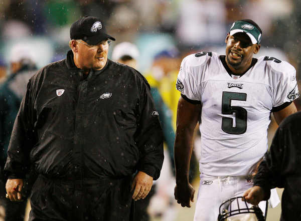 Philadelphia Eagles head coach Andy Reid, left and quarterback Donovan McNabb leave the field as the preseason football game with the Carolina Panthers was suspended in the first quarter because of lightning Thursday, Aug. 14, 2008, in Philadelphia. (AP Photo/Tom Mihalek)