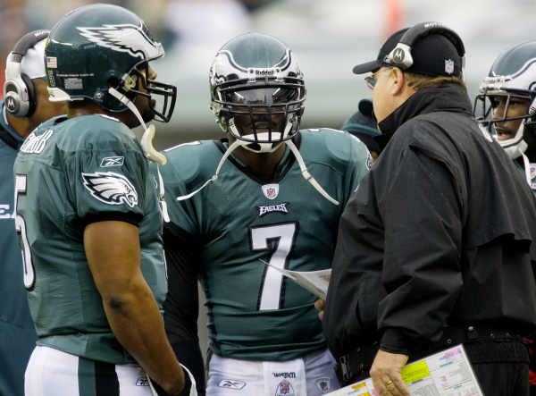 Philadelphia Eagles quarterbacks Donovan McNabb, left, and Michael Vick (7) talk with coach Andy Reid on the sidelines during a first quarter time out against the New York Giants in an NFL football game in Philadelphia, Sunday, Nov. 1, 2009. (AP Photo/Gene J. Puskar)