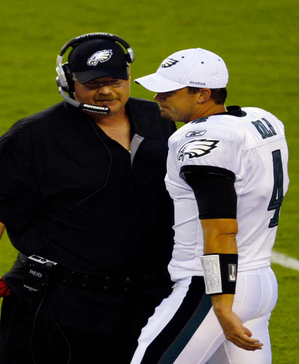 Philadelphia Eagles head coach Andy Reid, left, and quarterback Kevin Kolb talk in the first half of an NFL preseason football game against the Jacksonville Jaguars, Friday, Aug. 13, 2010, in Philadelphia. (AP Photo/Michael Perez)
