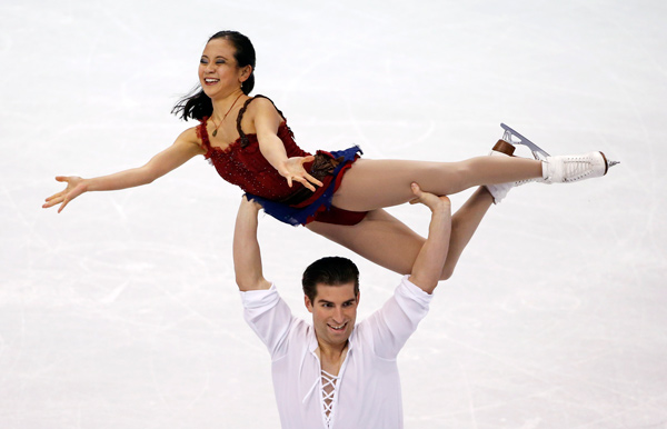 Felicia Zhang of Plainsboro, N.J. and Nathan Bartholomay compete during the pairs free skate at the U.S. Figure Skating Championships in Boston, Saturday, Jan. 11, 2014. (AP Photo/Elise Amendola)