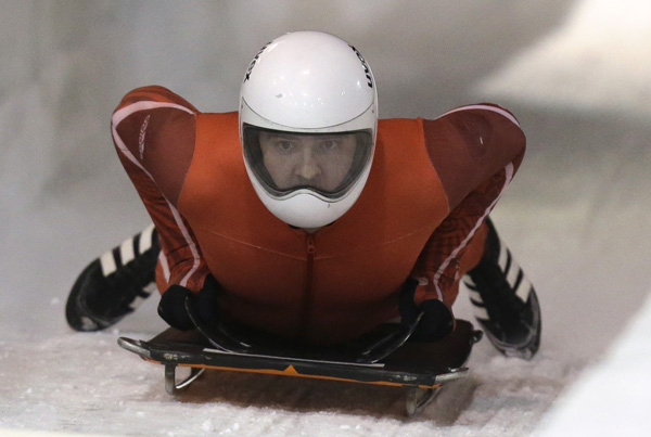 Kyle Tress, of Ewing, N.J., comes to a stop after competing during the United States men's skeleton team trials on Tuesday, Oct. 29, 2013, in Park City, Utah. (AP Photo/Rick Bowmer)