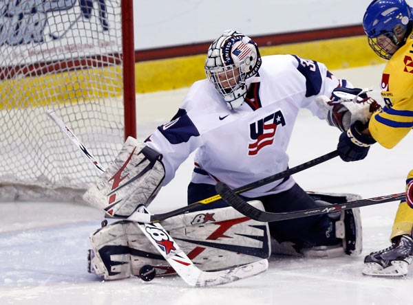 United States goalie Molly Schaus (30), of Voorhees, N.J., makes a save during the second period of a Four Nations Cup women's third-place hockey game against Sweden on Saturday, Nov. 9, 2013, in Lake Placid, N.Y. (AP Photo/Mike Groll)