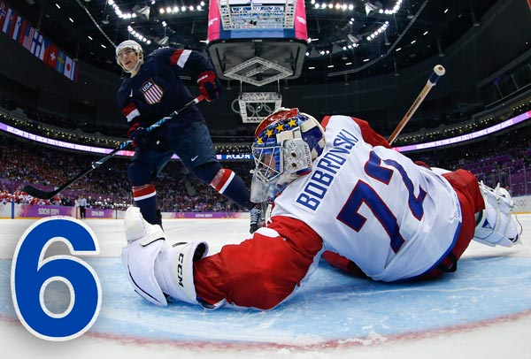 By The Numbers: Olympic Hero T.J. Oshie   6: T.J. Oshie scored on the Americans' first shot before taking the last five in a row, going 4 for 6 against Sergei Bobrovsky and disappointing a Bolshoy Ice Dome crowd including Russian President Vladimir Putin.    PHOTO: USA forward T.J. Oshie shoots against Russia goaltender Sergei Bobrovski in a shootout during overtime of a men's ice hockey game at the 2014 Winter Olympics, Saturday, Feb. 15, 2014, in Sochi, Russia. Oshie scored the winning goal and USA won 3-2. (AP Photo/Julio Cortez, Pool)