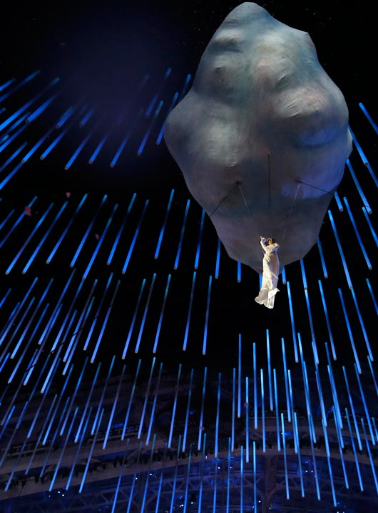 An artist is suspended as she performs during the closing ceremony of the 2014 Winter Olympics, Sunday, Feb. 23, 2014, in Sochi, Russia. (AP Photo/Darron Cummings)