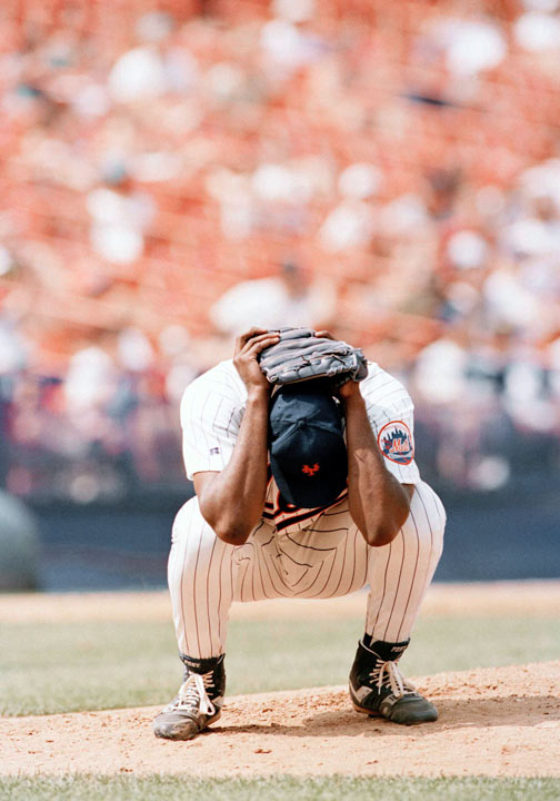 Anthony Young - New York Mets catcher Anthony Young buries his head in his hands after giving up a two-run home run in the eighth inning against the San Diego Padres in New York, on Wednesday, July 7, 1993. Padres Archi Cianfrocco's home run gave the Padres a 2-0 win. It was Young's 26th consecutive loss and he is 0-12 for the season. In a streak spanning 15 months across parts of two seasons, the New York Mets righty lost 27 consecutive decisions, 14 of them as a starter, 13 more as a reliever. (AP Photo/Mark Lennihan)