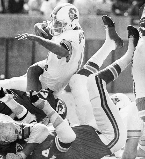 1976 Tampa Bay Buccaneers - FILE - In this Oct. 31, 1976 file photo, Tampa Bay Buccaneers quarterback Steve Spurrier is brought down in a pile of Kansas City Chiefs during an NFL football game in Tampa, Fla. Bad as the expansion Tampa Bay Buccaneers were in 1976, going 0-14 on the way to what became a 26-game losing streak, they never were as big of an underdog as the Jacksonville. (AP Photo/File)