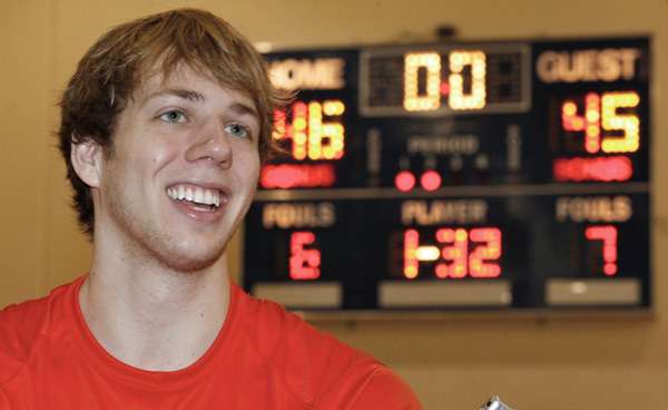 Cal Tech Men's Basketball - Caltech basketball player Ryan Elmquist poses with his team's winning scoreboard, background, in Pasadena, Calif. on Wednesday, Feb. 23, 2011. Elmquist hit the go-ahead free throw with 3 seconds left against Occidental College for the Division III Beavers, who had lost every Southern California Intercollegiate Athletic Conference game they had played since Jan. 23, 1985.  Their Southern California Intercollegiate Athletic Conference record between Jan. 23, 1985 (when they beat the University of La Verne, 48-47) and Feb. 22, 2011: 0-310.( AP Photo/Damian Dovarganes)
