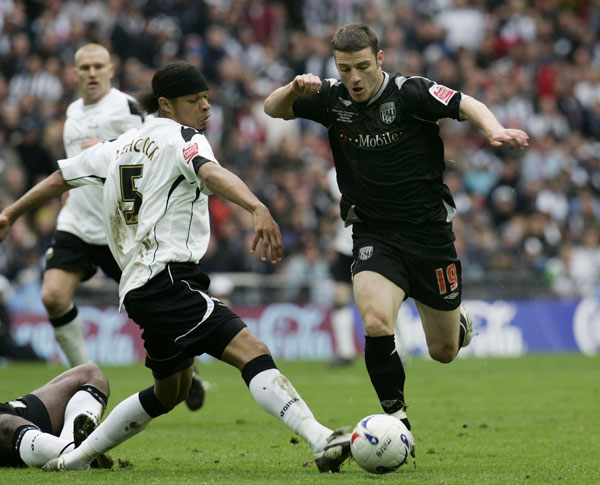 Derby County ? The Rams, playing their first top flight games in five years, notched their first and only victory of the 2007-08 Premier League season on September 17, 2007, 1-0 over Newcastle United. They would not repeat the act until September 14, 2008, 363 days later (it was a leap year), beating Sheffield United for their first win in 39 tries. Pictured a season prior, Derby County's Dean Leacock, left, tries to stop West Bromwich Albion's Jason Koumas, right, during their Leaugue Championship play-off final at the Wembley Stadium in London, Monday May 28, 2007. (AP Photo/Lefteris Pitarakis)