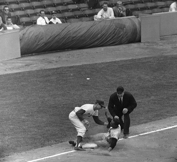 1961 Philadelphia Phillies ? From July 29 to Aug. 20, 1961, the Phillies lost 23 straight. This photo was taken a few weeks before the streak began, though they did lose this game, too. Willie Mays, San Francisco Giants centerfielder sliding safely into 3rd base in the 4th inning of game in Philadelphia on May 7, 1961 with the Philadelphia Phillies beating throw from Phillies center fielder Bobby Del Greco to 3rd base man Bob Sadowski. Umpire is Tom German. Giants defeated the Phillies 7-0. (AP Photo/SM)