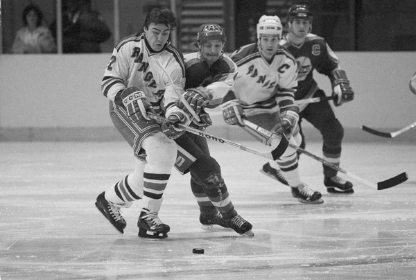1980-81 Winnipeg Jets - Not only did they manage to give up 400 goals in 80 games, but for a 30-game stretch during that season, the Jets did not record a win. This photo from a seaon later shows Nick Fortiu, left, left wing for the New York Rangers, battling Winnipeg Jets defenseman David Babych for the puck during game at Madison Square Garden in New York, Dec. 23, 1981. (AP Photo/Richard Drew)