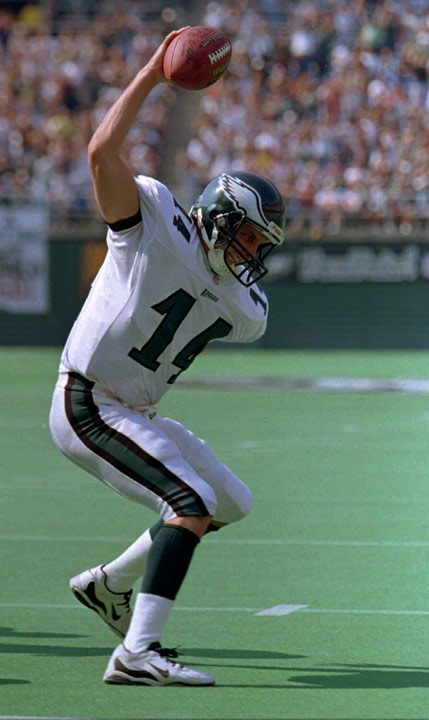 Philadelphia quarterback Ty Detmer spikes the ball in the end zone after his first quarter touchdown against the Washington Redskins Sunday, Sept. 5, 1997, in Philadelphia. Detmer joined the Eagles in 1996 as backup quarterback to Rodney Peete. (AP Photo/George Widman)