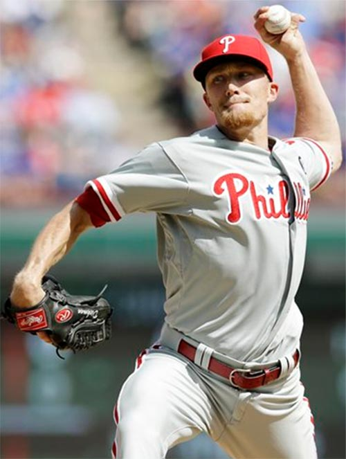 Philadelphia Phillies relief pitcher Jacob Diekman delivers the ball to the Texas Rangers during the sixth inning of an opening day baseball game at Globe Life Park, Monday, March 31, 2014, in Arlington, Texas. (AP Photo/Tony Gutierrez)