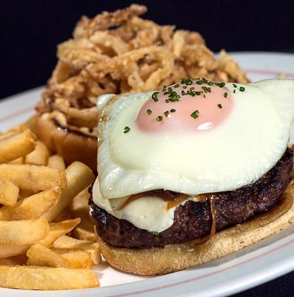 Fenway Park, home of the Boston Red Sox, is offering the new Breakfast Burger with mozzarella, egg, onions and special sauce.  (Photo: Darren Rovell)