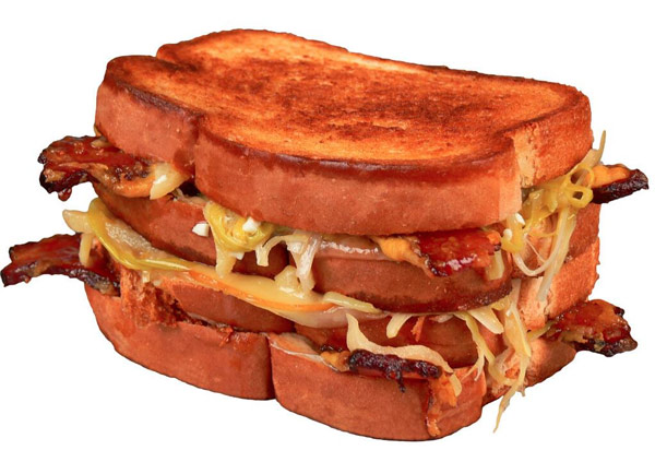"<div class=""meta ""><span class=""caption-text "">The Pittsbrugh Pirates introduce The Closer - a grilled cheese with 9 diffferent cheese and candied bacon. (Photo: Darren Rovell)</span></div>"