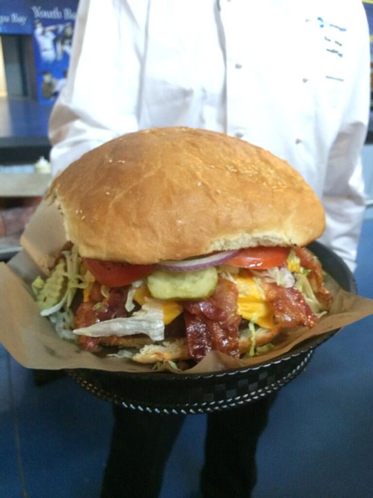 Tampa Bay Rays will sell this 4 pound burger for $30. Fans who can eat the 4-pound burger and a pound side of fries will be rewarded with two regular season tickets and a t-shirt. (Photo: Tampa Bay Rays)