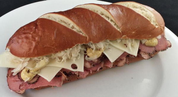 The Colorado Rockies are offering a Pretzel Pastrami sandwich w/ Russian dressing and Swiss cheese on a pretzel roll.  (Photo: Darren Rovell)