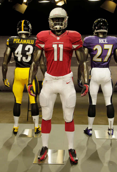 The new Arizona Cardinals uniform is displayed on a mannequin in New York, Tuesday, April 3, 2012. NFL has unveiled its new sleek uniforms designed by Nike. While most of the new uniforms are not very different visually, they all are made with new technology that make them lighter, dryer and more comfortable. (AP Photo/Seth Wenig)