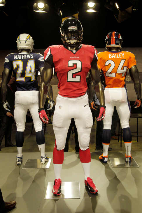The new Atlanta Falcons uniform is displayed on a mannequin in New York, Tuesday, April 3, 2012. NFL has unveiled its new sleek uniforms designed by Nike. While most of the new uniforms are not very different visually, they all are made with new technology that make them lighter, dryer and more comfortable. (AP Photo/Seth Wenig)