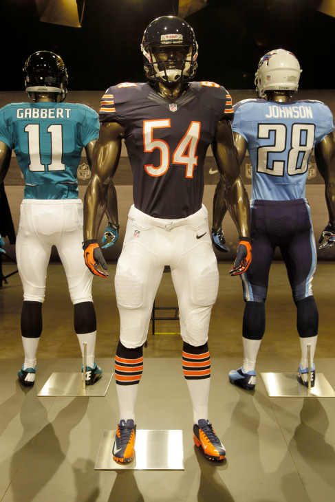 The new Chicago Bears uniform is displayed on a mannequin in New York, Tuesday, April 3, 2012. NFL has unveiled its new sleek uniforms designed by Nike. While most of the new uniforms are not very different visually, they all are made with new technology that make them lighter, dryer and more comfortable. (AP Photo/Seth Wenig)