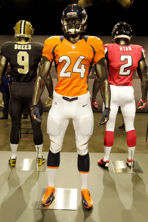 The new Denver Broncos uniform is displayed on a mannequin in New York, Tuesday, April 3, 2012. NFL has unveiled its new sleek uniforms designed by Nike. While most of the new uniforms are not very different visually, they all are made with new technology that make them lighter, dryer and more comfortable. (AP Photo/Seth Wenig)