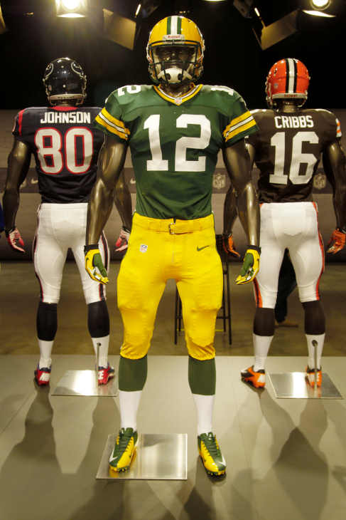 The new Green Bay Packers uniform is displayed on a mannequin in New York, Tuesday, April 3, 2012. NFL has unveiled its new sleek uniforms designed by Nike. While most of the new uniforms are not very different visually, they all are made with new technology that make them lighter, dryer and more comfortable. (AP Photo/Seth Wenig)