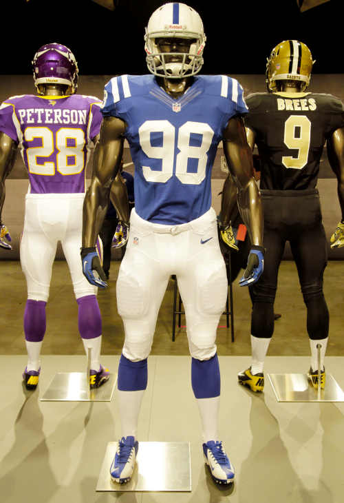 The new Indianapolis Colts uniform is displayed on a mannequin in New York, Tuesday, April 3, 2012. NFL has unveiled its new sleek uniforms designed by Nike. While most of the new uniforms are not very different visually, they all are made with new technology that make them lighter, dryer and more comfortable. (AP Photo/Seth Wenig)