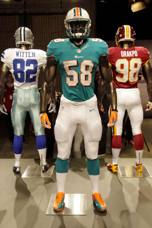 The new Miami Dolphins uniform is displayed on a mannequin in New York, Tuesday, April 3, 2012. NFL has unveiled its new sleek uniforms designed by Nike. While most of the new uniforms are not very different visually, they all are made with new technology that make them lighter, dryer and more comfortable. (AP Photo/Seth Wenig)