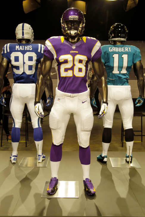 The new Minnesota Vikings uniform is displayed on a mannequin in New York, Tuesday, April 3, 2012. NFL has unveiled its new sleek uniforms designed by Nike. While most of the new uniforms are not very different visually, they all are made with new technology that make them lighter, dryer and more comfortable. (AP Photo/Seth Wenig)