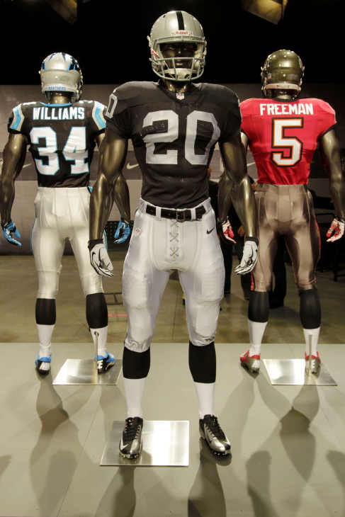 The new Oakland Raiders uniform is displayed on a mannequin in New York, Tuesday, April 3, 2012. NFL has unveiled its new sleek uniforms designed by Nike. While most of the new uniforms are not very different visually, they all are made with new technology that make them lighter, dryer and more comfortable. (AP Photo/Seth Wenig)