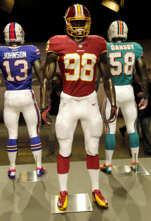 The new Washington Redskins uniform is displayed on a mannequin in New York, Tuesday, April 3, 2012. NFL has unveiled its new sleek uniforms designed by Nike. While most of the new uniforms are not very different visually, they all are made with new technology that make them lighter, dryer and more comfortable. (AP Photo/Seth Wenig)