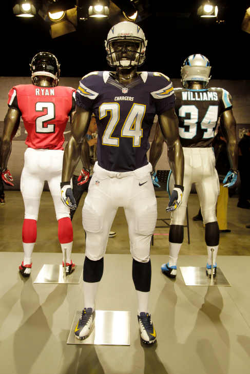 The new San Diego Chargers uniform is displayed on a mannequin in New York, Tuesday, April 3, 2012. NFL has unveiled its new sleek uniforms designed by Nike. While most of the new uniforms are not very different visually, they all are made with new technology that make them lighter, dryer and more comfortable. (AP Photo/Seth Wenig)