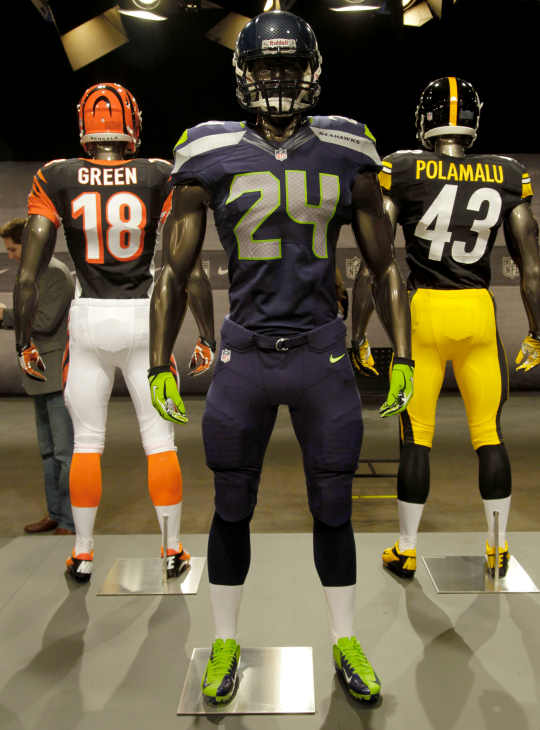 The new Seattle Seahawks uniform, foreground, Pittsburgh Steelers, rear right, and Cincinnati Bengals, rear left, are displayed on mannequins during a presentation in New York, Tuesday, April 3, 2012. The NFL and Nike showed off the new gear in grand style with a gridiron-themed fashion show at a Brooklyn film studio. (AP Photo/Seth Wenig)