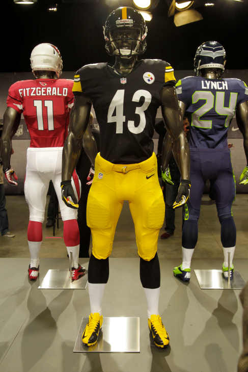 The new Pittsburgh Steelers uniform is displayed on a mannequin in New York, Tuesday, April 3, 2012. NFL has unveiled its new sleek uniforms designed by Nike. While most of the new uniforms are not very different visually, they all are made with new technology that make them lighter, dryer and more comfortable. (AP Photo/Seth Wenig)