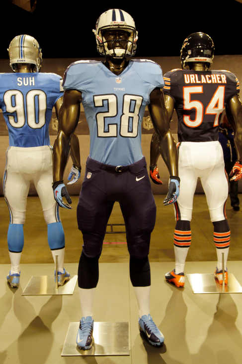The new Tennessee Titans uniform is displayed on a mannequin in New York, Tuesday, April 3, 2012. NFL has unveiled its new sleek uniforms designed by Nike. While most of the new uniforms are not very different visually, they all are made with new technology that make them lighter, dryer and more comfortable. (AP Photo/Seth Wenig)