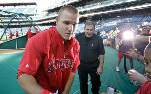 "<div class=""meta image-caption""><div class=""origin-logo origin-image ""><span></span></div><span class=""caption-text"">Mike Trout signs autographs before the start of a baseball game with the Philadelphia Phillies, Tuesday, May 13, 2014, in Philadelphia. (Photo/Laurence Kesterson)</span></div>"