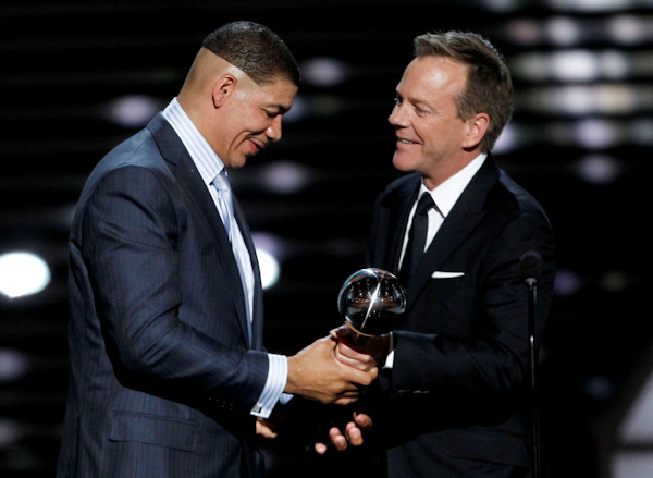 Dewey Bozella accepts the Arthur Ashe Award for Courage from Kiefer Sutherland at the ESPY Awards on Wednesday, July 13, 2011, in Los Angeles. (AP Photo/Matt Sayles)
