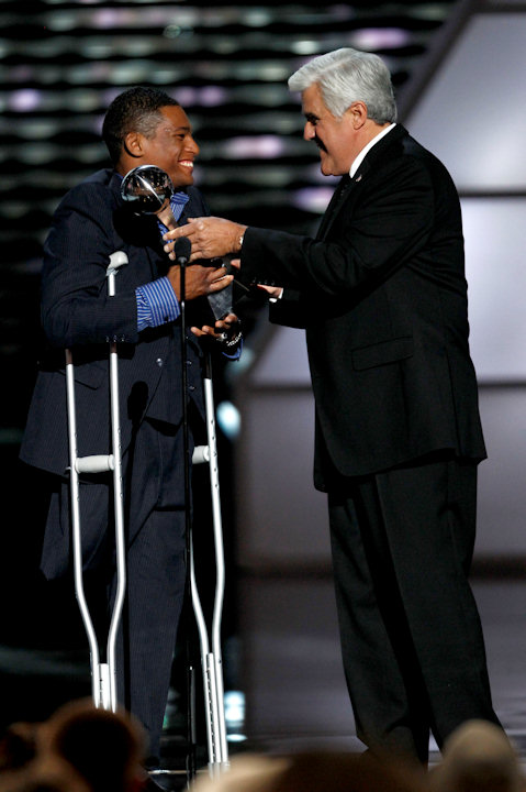Anthony Robles accepts the Jimmy V Award for Perseverance from Jay Leno at the ESPY Awards on Wednesday, July 13, 2011, in Los Angeles. (AP Photo/Matt Sayles)