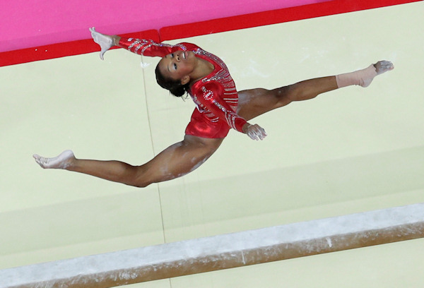 U.S. gymnast Gabrielle Douglas performs on the balance beam during the Artistic Gymnastic women's team final at the 2012 Summer Olympics, Tuesday, July 31, 2012, in London. (AP Photo/Julie Jacobson)
