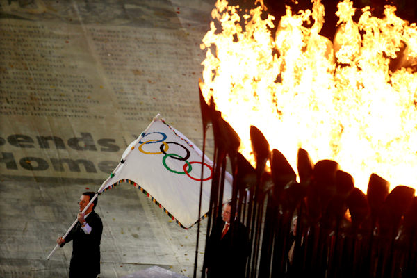 "<div class=""meta image-caption""><div class=""origin-logo origin-image ""><span></span></div><span class=""caption-text"">Eduardo Paes, Mayor Rio de Janeiro, the host city of the 2016 Summer Olympics, waves the Olympic flag during the Closing Ceremony at the 2012 Summer Olympics, Sunday, Aug. 12, 2012, in London. (AP Photo/Ivan Sekretarev)   </span></div>"