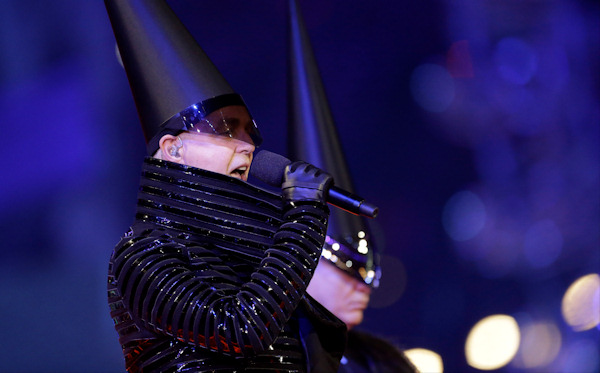 Neil Tennant, singer of the Pet Shop Boys, performs during the Closing Ceremony at the 2012 Summer Olympics, Sunday, Aug. 12, 2012, in London. (AP Photo/Patrick Semansky)