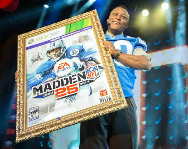 NFL hall of fame running back Barry Sanders holds up a mock up of the Madden 25 video game cover during the EA Sports Madden NFL 25 Cover Reveal on SportsNation on Wednesday, April, 24, 2013 in New York, New York.   <span class=meta>(&#40;Photo by Chris Park&#47;Invision for EA Sports&#47;AP Images&#41;)</span>