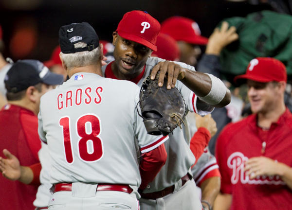 "<div class=""meta ""><span class=""caption-text "">Philadelphia Phillies first baseman Ryan Howard, center, gets a hug from hitting coach hitting coach Greg Gross after the Phillies  defeated the Washington Nationals 8-0 to clinch the National League East on Monday, Sept. 27, 2010, in Washington.  (AP Photo/Evan Vucci)</span></div>"