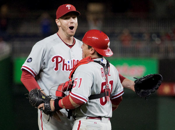 Philadelphia Phillies pitcher Roy Halladay, left, celebrates with catcher Carlos Ruiz after pitching a complete game shutout to help the Phillies  defeat the Washington Nationals 8-0 to clinch the National League East on Monday, Sept. 27, 2010, in Washington.  <span class=meta>(AP Photo&#47;Evan Vucci)</span>