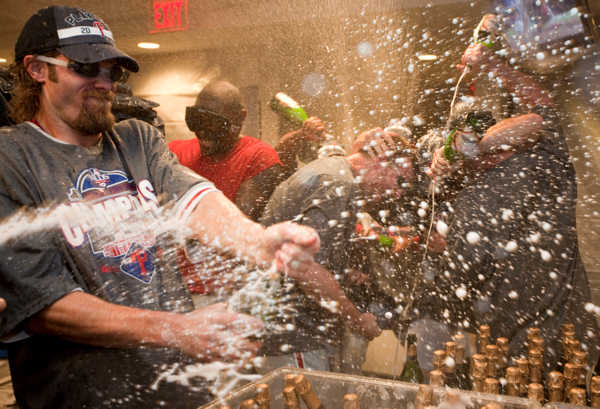 Philadelphia Phillies&#39; Jayson Werth celebrates after the Phillies  defeated the Washington Nationals 8-0 to clinch the National League East on Monday, Sept. 27, 2010, in Washington. Werth had four RBIs.  <span class=meta>(AP Photo&#47;Evan Vucci)</span>
