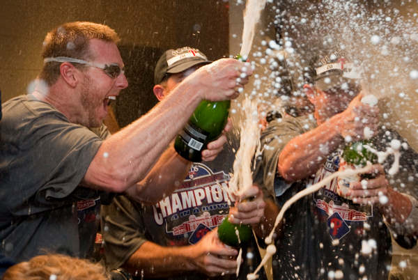 Philadelphia Phillies pitcher Roy Halladay, left, celebrates with teammates after the Phillies  defeated the Washington Nationals 8-0 to clinch the National League East on Monday, Sept. 27, 2010, in Washington. Halladay pitched a complete game. <span class=meta>(AP Photo&#47;Evan Vucci)</span>