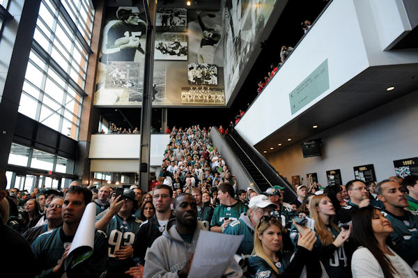 Spectators watch during a news conference announcing the jersey retirement of former Philadelphia Eagles safety Brian Dawkins before an NFL football game between the Philadelphia Eagles and the New York Giants Sunday, Sept. 30, 2012, in Philadelphia. (AP Photo/Michael Perez)