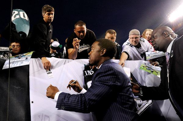 Former Philadelphia Eagles safety Brian Dawkins signs autographs before an NFL football game between the Philadelphia Eagles and the New York Giants Sunday, Sept. 30, 2012, in Philadelphia. The Eagles retired Dawkins number during the a pre-game news conference. (AP Photo/Michael Perez)